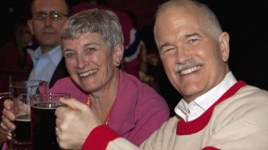 NDP Leader Jack Layton raises his mug of beer with his sister Nancy while watching the first period of the Montreal Canadiens and Boston Bruins game on television in a sports bar in Montreal, Thursday, April 14, 2011. (Jacques Boissinot / THE CANADIAN PRESS)