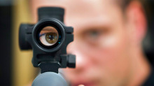 Patrick Deegan, a senior range officer at the Shooting Edge, looks through the scope of long gun at the store in Calgary, Wednesday, Sept. 15, 2010.