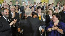 NDP Leader Jack Layton hugs his wife, Toronto MP Olivia Chow, after speaking to his caucus in Ottawa on May 24, 2011.