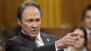 NDP MP Pat Martin was served with a $5-million lawsuit Friday because of comments he has made about RackNine Inc.